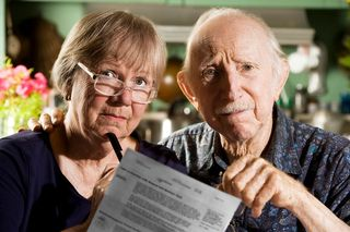 Bigstock-Elder-Couple-With-Bills-3557267_preview
