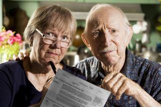 Bigstock-Elder-Couple-With-Bills-3557267[2]