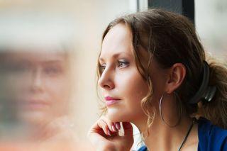 Bigstock-Beautiful-woman-looking-throug-20311445[1]