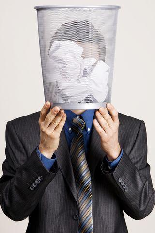 Bigstock-Young-man-holding-a-trash-bin--26453660[2]