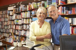 Bigstock-Couple-running-bookshop-13904324[1]