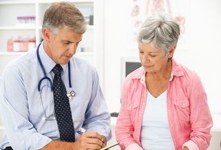 Bigstock-Doctor-with-female-patient-21258332[2]